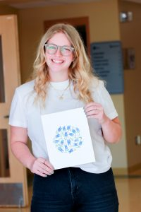 Third-year student, Kirsten Hildebrand, created art to sell as a fundraiser for MX3.